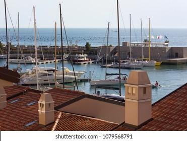 DUINO AURISINA, Italy - April 14, 2018: Marina of Portopiccolo luxury seaside resort near Trieste, seen from the rooftops