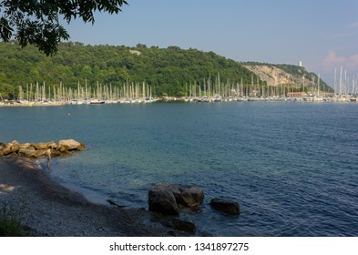 DUINO AURISINA, Italy - June 15, 2017: Shady beach in a late summer afternoon in the Sistiana bay
