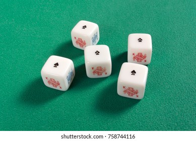DUINO AURISINA, Italy - November 16, 2017: Poker dice on a green table with a five of a kind of aces