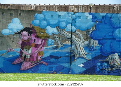 DUISBURG, GERMANY - 07 July 2013 The river bank Rhine. Graffiti-surrealistic-art, portraits, also fantastic dragons and other creative characters on old walls which remained from a former steel mill.