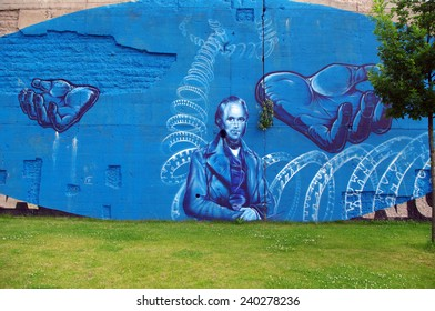 DUISBURG, GERMANY - 12 June 2013 The river bank Rhine. Graffiti-surrealist ic-art, portraits, also fantastic dragons and other creative characters on old walls which remained from a former steel mill.