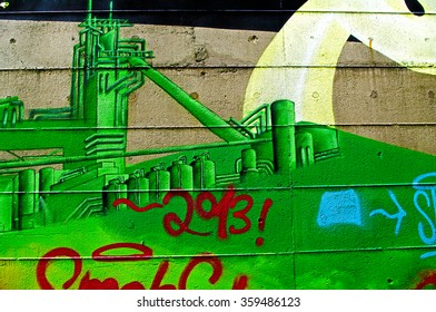 DUISBURG, GERMANY - 12 June 2013 The river bank Rhine. Graffiti-surrealist ic-art on old walls which remained from a former steel mill closeup