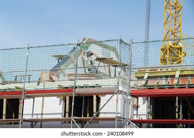 DUISBURG, GERMANY - 18 June 2013 Construction site of cottages in the city with a using vehicles, equipment and humans