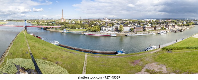 DUISBURG / GERMANY - OCTOBER 03 2017 : The Friedrich-Ebert Bridge over the river Rhine is connecting Ruhrort and Homberg, aerial from the Mercator Island