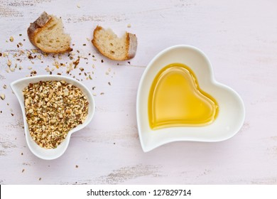 Dukkah with crusted bread and olive oil in heart shaped bowls