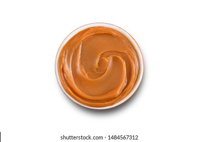 Dulce de leche bowl isolated on white
