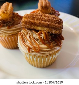Dulce de Leche Churro Cupcakes consists of butter cake, cinnamon buttercream frosting, churro, and drizzled with dulce de leche.