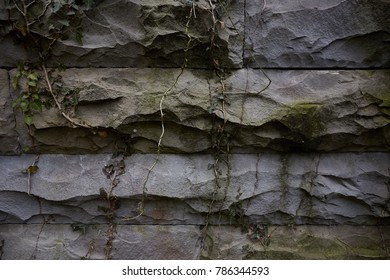 The dull stone walls of Sandstone, sometimes overgrown with moss, ivy sometimes. Old stone in the entire area of the frame.