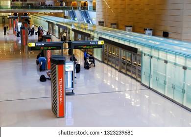 Dulles, VA, USA May 9, 2013 Travelers await the next Terminal train at Dulles International Airport in Dulles, Virginia