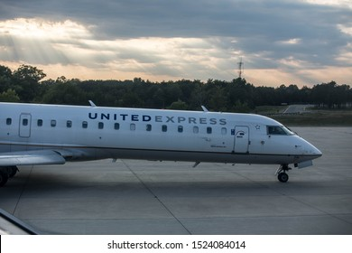 Dulles, Virginia - September 16 2019: The front fuselage of a United Express Regional Jet (operated by Mesa Airlines) on the tarmac of Washington Dulles International Airport (IAD)