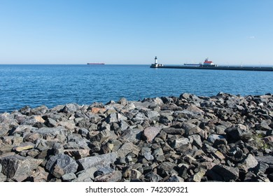 The Duluth Harbor Breakwater Lighthouse, also known as the Canal Park Lighthouse, sits on Lake Superior on a clear sunny day