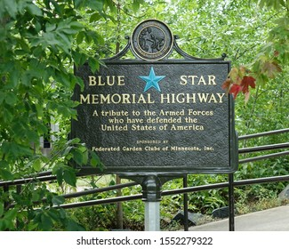 Duluth, Minnesota/US-August 31, 2019: National Garden Clubs, Inc. Blue Star Memorial Highway park marker framed by early fall leaves. Thompson Hill recreation area.