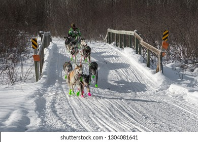 DULUTH, MN - JANUARY 27, 2019: Ryan Redington's team crosses bridge during the John Beargrease Sled Dog Marathon. Redington led for most of the race but finished 6th on January 29th in Grand Portage.