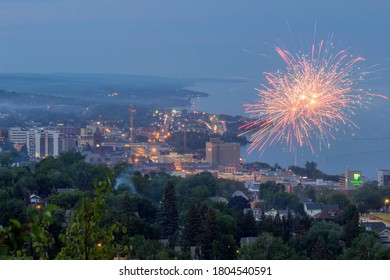 DULUTH, MN - JULY 2020 - Fourth of July Fireworks over the Duluth, MN Skyline and Lake Superior during Twilight
