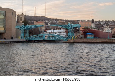 DULUTH, MN - OCTOBER 2020 - A Golden Shot of the Minnesota Slip Bridge and William A. Irvin in Duluth on a Beautiful Fall Evening
