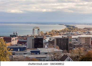 DULUTH, MN - OCTOBER 2020 - A High Angle View of Downtown Duluth, the Aerial Lift Bridge, and Minnesota Point on Lake Superior on a Beautiful Fall Day