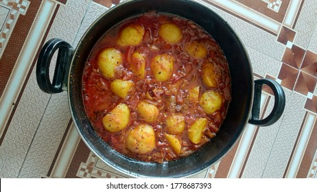 Dum Aloo or Aloo dum, popular Indian dish. Spices and flavoured with chilli, garlic and fennel in smooth gravy which coat the fried potatoes.   - Shutterstock ID 1778687393