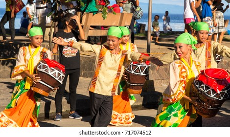 Dumaguete, Philippines - 16 September, 2017: street dance at Sandurot Festival. Carnival with dancing and drum music. Children in national costume. Philippines festival tradition. Autumn festival
