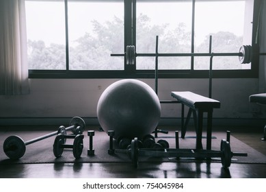 Dumbbell at fitness Gym to build muscle,Fitness club weight training equipment,heavy weights barbell on the floor in GYM.
