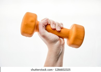 dumbbell in hand on white background