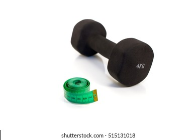 Dumbbell and measuring tape on a white background. Isolated.
