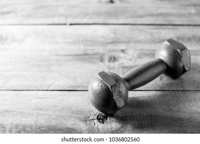 dumbbell on wooden table background