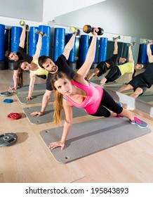 Dumbbell push up group functional training circuit at fitness gym
