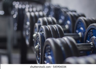 Dumbbell weights,Rows of dumbbells in the gym.