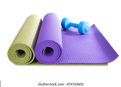 dumbbell and yoga mats on white background
