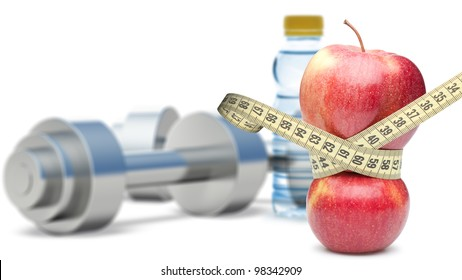 Dumbbells with an apple and measuring type. Dumbbells blured on a background. It is isolated on a white background