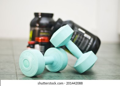 Dumbbells with booster and gainer