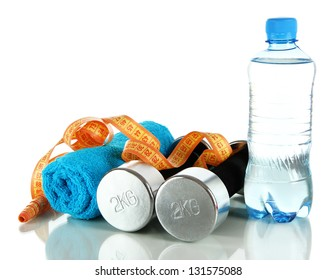 Dumbbells with centimeter,towel and bottle of water isolated on white