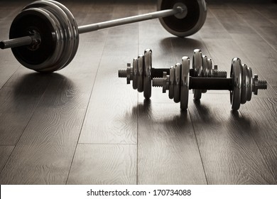 The dumbbells for fitness on wooden floor with empty space