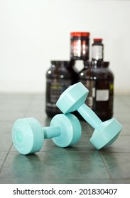 Dumbbells with gainder at the background