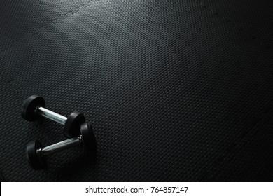 Dumbbells on empty floor in Gym