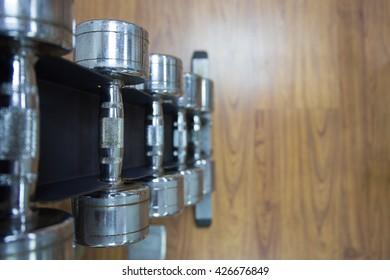 dumbbells on rack in  on wood floor workout room