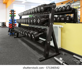 Dumbbells on stand in a gym