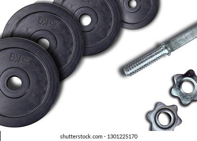 Dumbbells and weights are lying on the floor in the gym. Barbell set and gym equipment. Metal loads in the fitness club