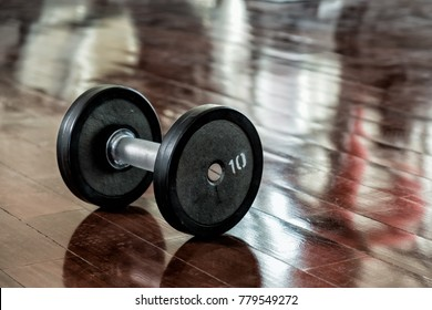 Dumbell on wooden floor, fitness and healthy concept