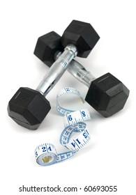 Dumbells and a measuring tape isolated against a white background