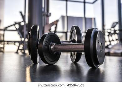 Dumbells on the floor in fitness room, Selective focus