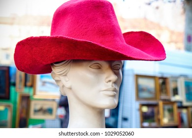 Dummy head wearing a red hat