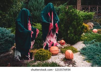 Dummy monks Halloween decoration with pumpkins