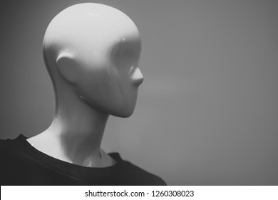 Dummy on gray background. Female or male mannequin wearing black sweater. Dummy head for boutique. Fashion, style, beauty, design, trend, luxury, modern, outfit, shopping concept. Dress form or model