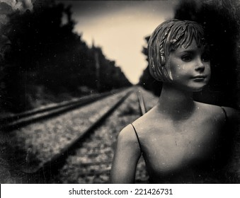 Dummy on railway tracks. Film scan filtered and processed with vintage effect
