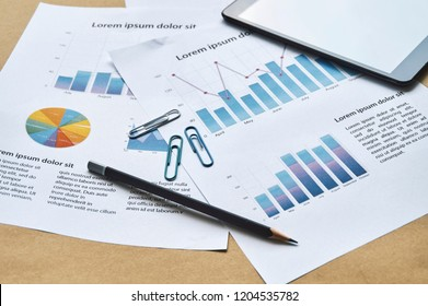 Dummy paperwork of sales report with pie chart, bar and line graph, statistics report. Meeting room workplace. Business concept. Close up.