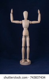 dummy with raised hands with a blue background