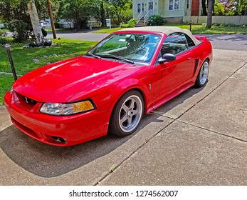 DUMONT, NEW JERSEY/USA - AUGUST 10, 2018: A 1999 Ford Mustang Cobra convertible parked in a driveway in a residential area. The Mustang Cobras in that year had 320 horsepower and a 5-speed.