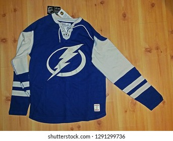 DUMONT, NEW JERSEY/USA - OCTOBER 2, 2016: A CCM Athletic Equipment long sleeve Tampa Bay Lightning crewneck jersey on display. There is a lightning bolt on the front of this officially licensed shirt.