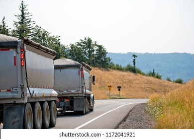 A dump big rig semi truck with bulk cargo is the most common on all roads in America, as it is an integral part of the road transport infrastructure, which is the main type of industrial logistics